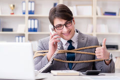 The businessman tied up with rope in office. Businessman tied up with rope in office Royalty Free Stock Images