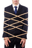Businessman tied up with rope. On white Stock Photo