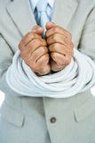 Businessman tied up in rope. On white background Royalty Free Stock Images