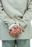 Businessman tied up in rope. On white background Stock Image