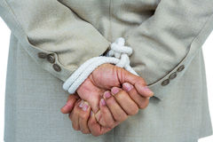 Businessman tied up in rope. On white background Stock Images
