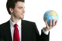 Businessman tien suit with world ball map in hand Stock Photography