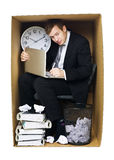 Businessman in a tight office Royalty Free Stock Images
