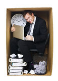 Businessman in a tight office Stock Photos