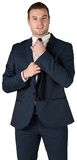 Businessman tightening his tie Stock Images