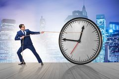 The businessman in time management concept. Businessman in time management concept Stock Photos