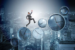 The businessman in time management concept Stock Photo