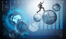 The businessman in time management concept. Businessman in time management concept Royalty Free Stock Photos