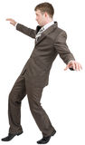 Businessman on tiptoes Stock Image