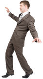 Businessman on tiptoes Stock Images