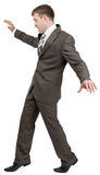 Businessman on tiptoes Stock Photo