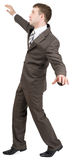 Businessman on tiptoes Stock Photography