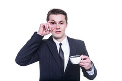 Businessman tired and falling asleep drinking a coffee Stock Photography