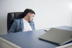 Businessman tired overworked sleeping on office desk.  Royalty Free Stock Photo