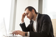 Businessman tired from routine work on laptop stock images