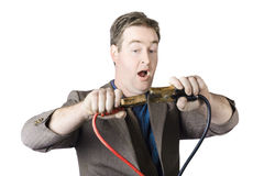 Businessman About To Connect Jumper Cable Royalty Free Stock Photos
