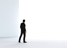Businessman about to cross the entrance to the light. Stock Photography