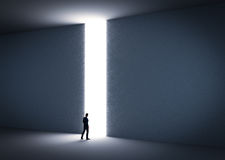 Businessman about to cross the entrance to the light. Royalty Free Stock Photos
