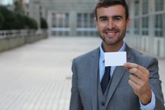 Businessman about to give you his business card away with space for editing and copy Stock Photos