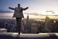 Businessman about to jump from a building stock image