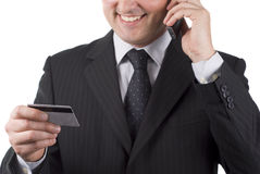 Businessman to phone Royalty Free Stock Image