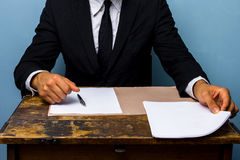 Businessman about to sign a deal Stock Photos
