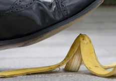 Businessman stepping on a banana skin, work accident, risk Stock Photography