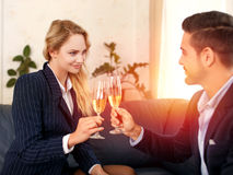Businessman toast with businesswoman in sunset Stock Photo