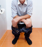 Businessman in toilet Royalty Free Stock Image