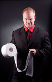 Businessman with toilette paper Royalty Free Stock Images