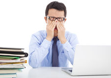 Businessman is too fatigued to rubbing his eyes. In office stock photo