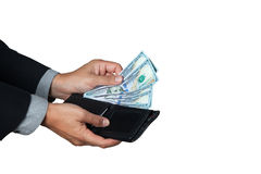 The businessman took dollar out of his wallet. Royalty Free Stock Photography