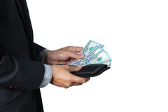The businessman took dollar out of his wallet. Royalty Free Stock Photo