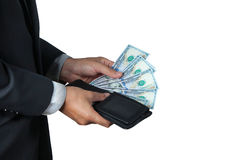 The businessman took dollar out of his wallet. Stock Images