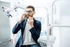 Businessman with toothache in the dental office royalty free stock images
