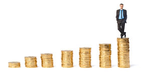Businessman on top the gold coins Stock Photo