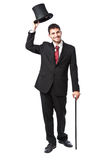 Businessman with Top Hat. And walking stick in a suite Royalty Free Stock Image