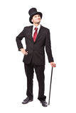 Businessman with Top Hat. And walking stick in a suite Royalty Free Stock Photos