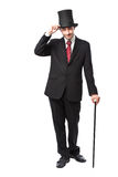 Businessman with Top Hat. And walking stick in a suite Royalty Free Stock Photography