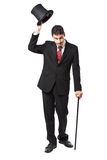 Businessman with Top Hat. And walking stick in a suite Stock Photos