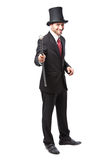 Businessman with Top Hat. And walking stick in a suite Royalty Free Stock Photo