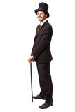 Businessman with Top Hat. And walking stick in a suite Stock Photography
