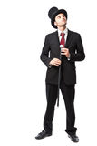 Businessman with Top Hat. And walking stick in a suite Royalty Free Stock Images