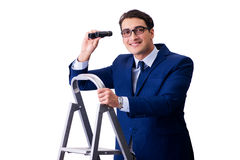 The businessman at top of ladder with binoculars Royalty Free Stock Photography