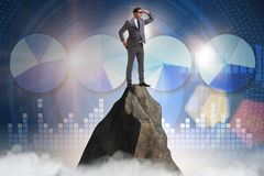 The businessman at the top of mountain. Businessman at the top of mountain stock photography