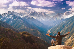 The businessman at the top of the mountain is pleased with the a Royalty Free Stock Photo
