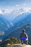 Businessman at the top of mountain is thinking Royalty Free Stock Images