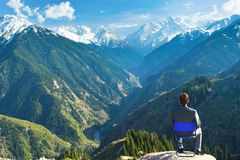 The businessman at the top of the mountain is thinking about fut Royalty Free Stock Photo