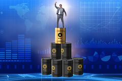 The businessman on top of oil barrels Royalty Free Stock Image