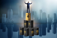 The businessman on top of oil barrels Royalty Free Stock Photography